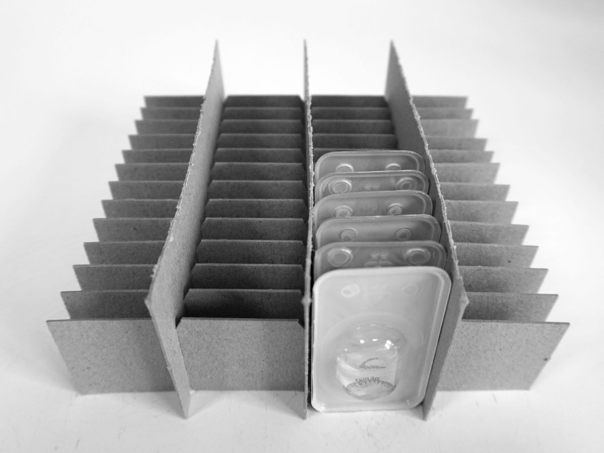 Grid compartment inserts, compartments, transport packaging and cardboard boxes for pharmaceutical and chemical products, packing compartments, compartment packaging, made-to-measure compartments, packaging for serial parts, - MÖLLE GmbH